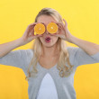 Woman with oranges for eyes — Stock Photo