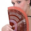 Stock Photo: Womholding fan