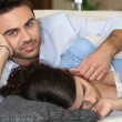 Man caressing his sleeping wife - Stock Photo