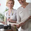 Stock Photo: Couple cooking together in kitchen