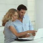 Couple at work on laptops — Stock Photo #7717609