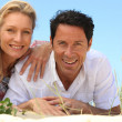 Stock Photo: Couple lying on sand.