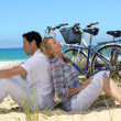 Couple on the beach with bikes — Stock Photo #7717797