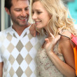 Stock Photo: Couple on happy shopping trip