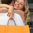 Stock Photo: Cuddle with shopping bag