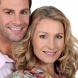 Headshot of smiling couple - Stock Photo