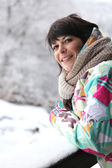 Woman wrapped up in the snow — Stock Photo