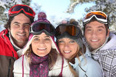 Portrait of a family on a skiing holiday together — Stock Photo