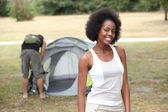 Couple pitching tend in campsite — Stock Photo