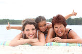 Three generations - grandmother, mother and daughter - on the beach — Stock Photo