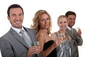 Couples drinking champagne — Stock Photo