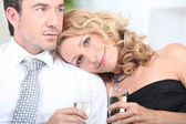 Couple with a glass of champagne — Stock Photo