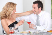 Husband and wife enjoying romantic meal — Stock Photo