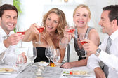 Group of adults having a dinner — Stock Photo