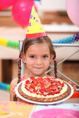 Portrait of a little girl with birthday cake — Stock Photo