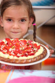 Little girl with a tart — Stock Photo