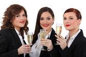 Three elegant women drinking champagne — Stock Photo
