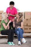 Group of friends celebrating on moving day — Stock Photo