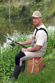 Portrait of a man fishing — Stock Photo