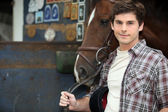 Young man with horse — Stock Photo