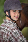Portrait of a young horseback rider — Stock Photo