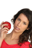 Woman displaying red apple — Stock Photo