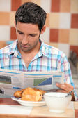 Guy having breakfast — Stock Photo