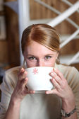 Woman drinking from coffee bowl — Stock Photo