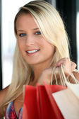 Young woman with store bags — Stock Photo