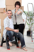 Couple celebrating moving into their new home — Stock Photo