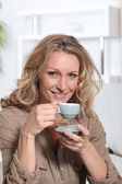 Woman drinking an expresso — Stock Photo