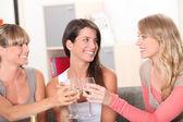 Three housemates drinking wine together — Stock Photo