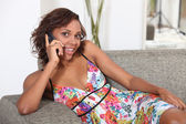 Afro American woman talking on her cell phone — Stock Photo