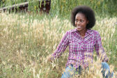 Coloured girl in high grass — Stock Photo