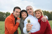 A family posing for a photo — Stock Photo