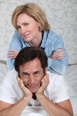 Relaxed couple laid on a bed — Stock Photo