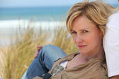 Portrait of a woman on the beach — Stock Photo
