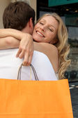 Cuddle with shopping bag — Stock Photo
