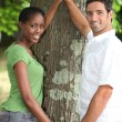 Couple touching tree — Stock Photo #7731906