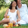 Couple relaxing outside — Stock Photo