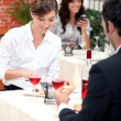 Stock Photo: Couple eating in restaurant