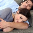 Couple lying on sofa — Stock Photo