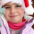 Little girl wearing Santa hat — Stock Photo #7733099