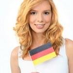 Pretty woman waving a German flag — Stock Photo