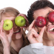 Royalty-Free Stock Photo: Couple pulling silly faces with apples