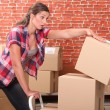 Woman dropping packing boxes — Stock Photo