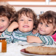 Three sisters enjoying crepes. — Stock Photo