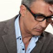 Stressed businessman wearing glasses — Stock Photo #7735298