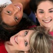 Three female friends laying together — Stock Photo