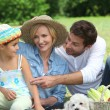 Family with small white dog — Stock Photo #7738429